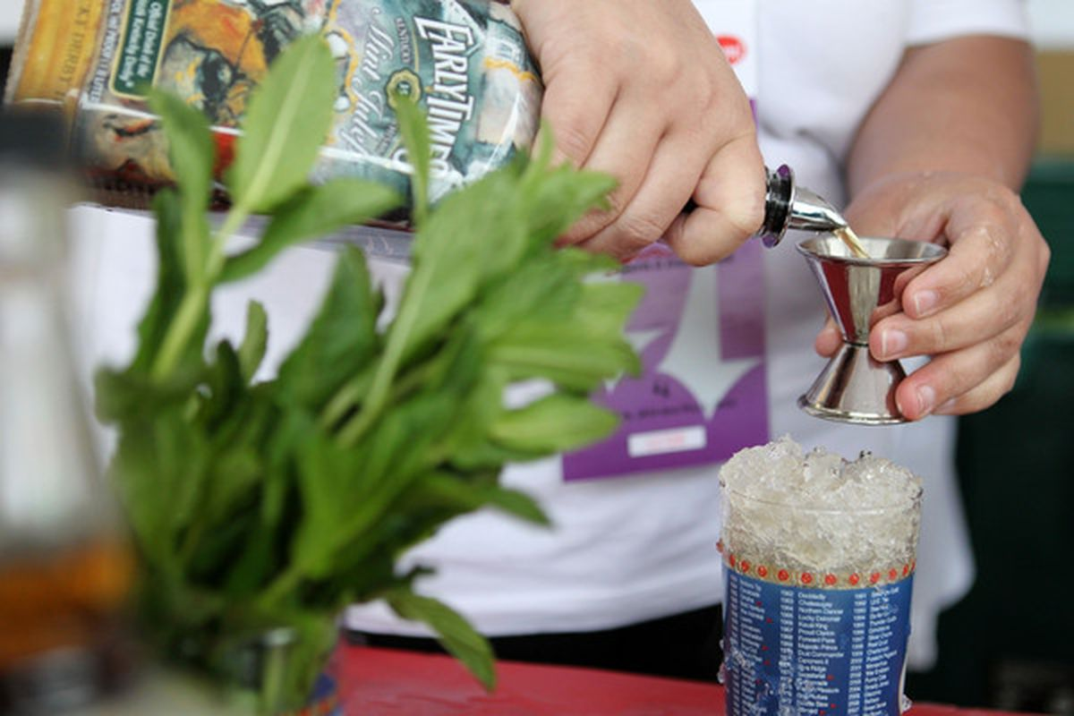 LOUISVILLE, KY - MAY 01:  A bartender makes a mint julep prior to the 136th running of the Kentucky Derby on May 1, 2010 in Louisville, Kentucky.  (Photo by Jamie Squire/Getty Images)