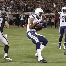 San Diego Chargers wide receiver Malcom Floyd (80) catches a touchdown pass from quarterback Philip Rivers during the second quarter of an NFL football game against the Oakland Raiders in Oakland, Calif., Monday, Sept. 10, 2012.