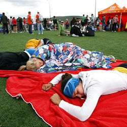 BYU students Jennifer Kerr, Janelle Possin, Connor Clark and high schooler Courtney McCann rest at the finish area of the Ragnar Relay Wasatch Back race in Park City after competing with Team Cyborg Nebulizers on Saturday.