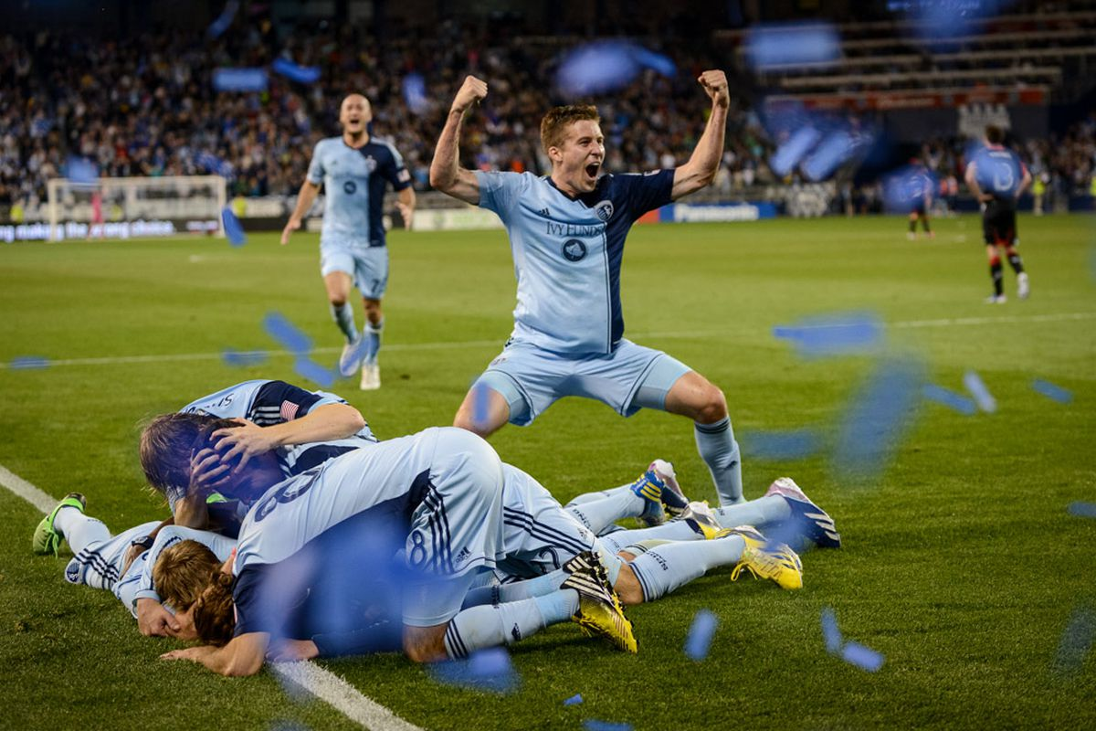 Matt Besler flexes his might as teammates celebrate Claudio Bieler's game-winning goal in the 89th minute against D.C. United at Sporting Park.