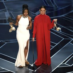 Tiffany Haddish, left, and Maya Rudolph present the award for best documentary short subject at the Oscars on Sunday, March 4, 2018, at the Dolby Theatre in Los Angeles.