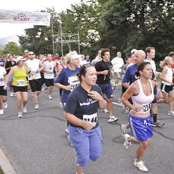 Runners participate in the Deseret News 10K race that started in Research Park and ended in Liberty Park in Salt Lake City Saturday.
