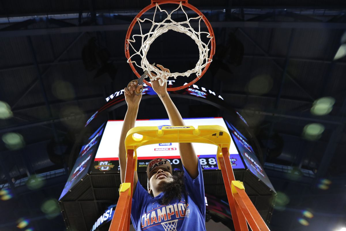 DePaul's Deja Church cuts down the net after a win over Marquette in an NCAA college basketball game in the Big East women's tournament final, Monday, March 9, 2020, in Chicago. (AP Photo/Nam Y. Huh) ORG XMIT: ILNH126