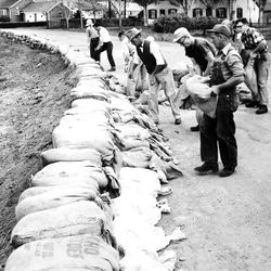 Salt Lake homeowners building a sandbag wall to keep water out in May of 1952.