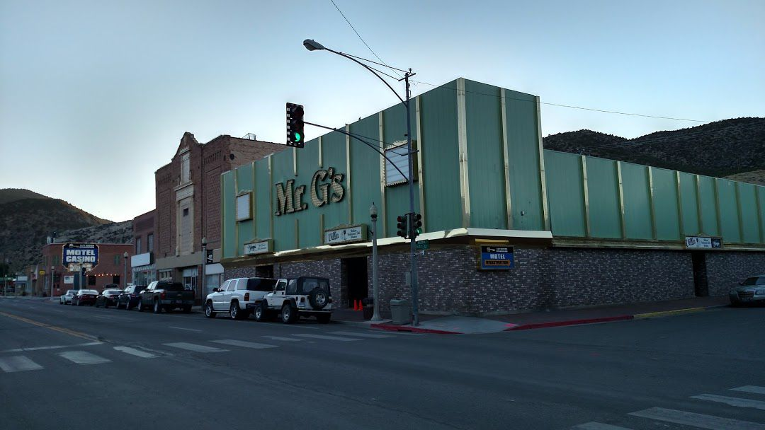 Exterior of a green restaurant with the words Mr. G's on the front
