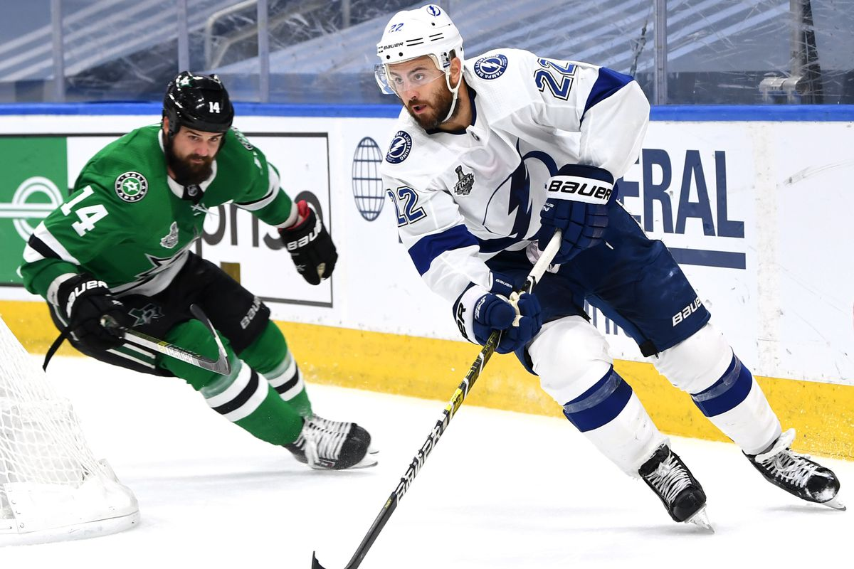 Kevin Shattenkirk #22 of the Tampa Bay Lightning controls the puck as Jamie Benn #14 of the Dallas Stars pursues the play in the third period of Game Four of the NHL Stanley Cup Final between the Tampa Bay Lightning and the Dallas Stars at Rogers Place on September 25, 2020 in Edmonton, Alberta, Canada.