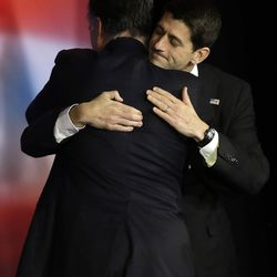 Republican presidential candidate and former Massachusetts Gov. Mitt Romney embraces Republican vice presidential candidate, Rep. Paul Ryan, R-Wis., after Romney conceded the race during his election night rally, Wednesday, Nov. 7, 2012, in Boston.