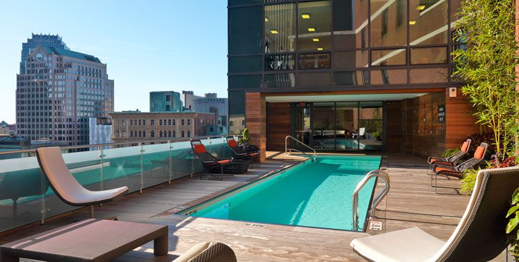 An outdoor swimming pool with a lounge area.