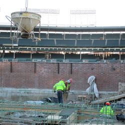 The concrete bucket being lifted overhead in the left-field bleachers on Waveland