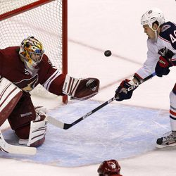 Phoenix Coyotes' Mike Smith (41) makes a save on a shot by Columbus Blue Jackets' Jared Boll (40) during the third period in an NHL hockey game on Tuesday, April 3, 2012, in Glendale, Ariz.  The Coyotes defeated the Blue Jackets 2-0.