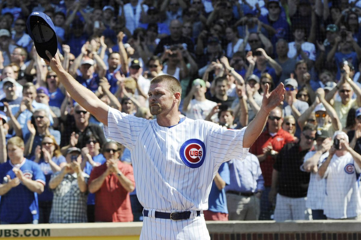 Kerry Wood of the Chicago Cubs waves to fans after leaving the game against the Chicago White Sox at Wrigley Field in Chicago, Illinois. inning. It was announced that Kerry Wood is retiring from baseball today.  (Photo by David Banks/Getty Images)