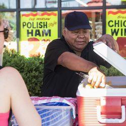 Felipe Vallarta, 58, an elotero, serves corn in Rogers Park.   Ashlee Rezin/Sun-Times