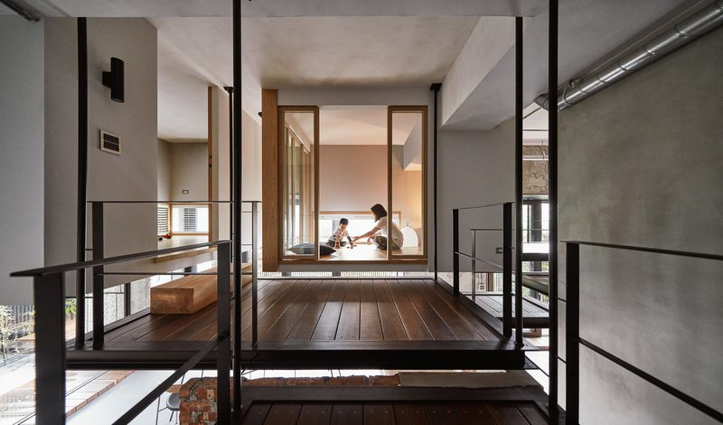 A wooden platform leads to a private room.