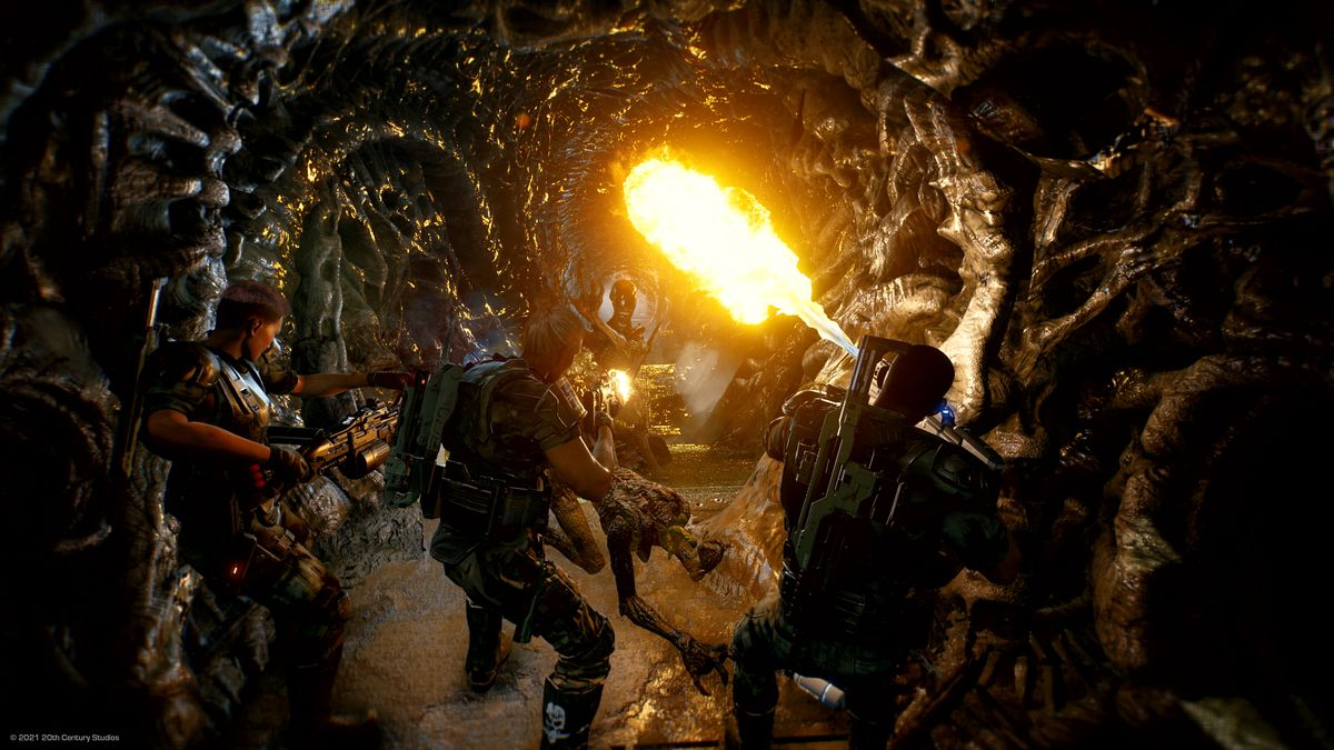 Colonial Marines use a flamethrower in a Xenomorph hive in Aliens: Fireteam.