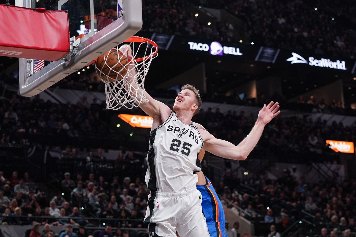 San Antonio Spurs center Jakob Poeltl dunks the ball against the Oklahoma City Thunder during the first half at the AT&T Center.