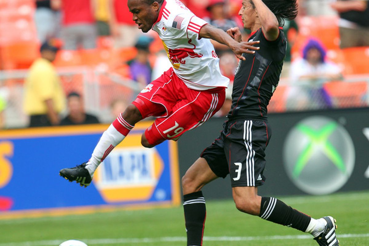Dane Richards of the New York Red Bulls avoids a tackle against Juan Manuel Pena of D.C. United. (Photo by Ned Dishman/Getty Images)