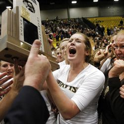 Davis' Adria Downs, center, begins to scream as she and her teammates celebrate their state championship.