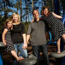 Hillary and Bryan Cole pose for a photograph with their daughters Hazel, 5, and Hannah, 8,  at Jetton Park Tuesday, April 12, 2017, in Cornelius, North Carolina.