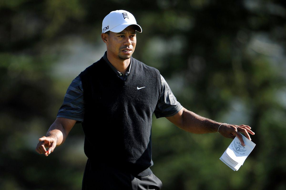 DALY CITY, CA - JUNE 11:  Tiger Woods of the United States reacts during a practice round prior to the start of the 112th U.S. Open at The Olympic Club on June 11, 2012 in Daly City, California.  (Photo by Stuart Franklin/Getty Images)