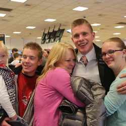 Kayden Carlos reunites with his family at Salt Lake City International Airport on Thanksgiving Day, 2016.