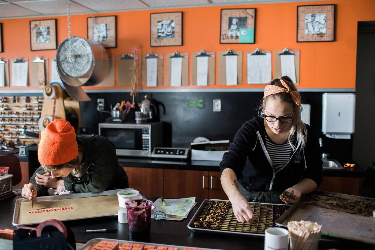 two women making chocolate