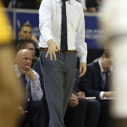 Utah State head coach Craig Smith instructs his team against Wyoming during the second half of an NCAA college basketball game in the Mountain West Conference men's tournament Friday, March 6, 2020, in Las Vegas. Utah State won 89-82.