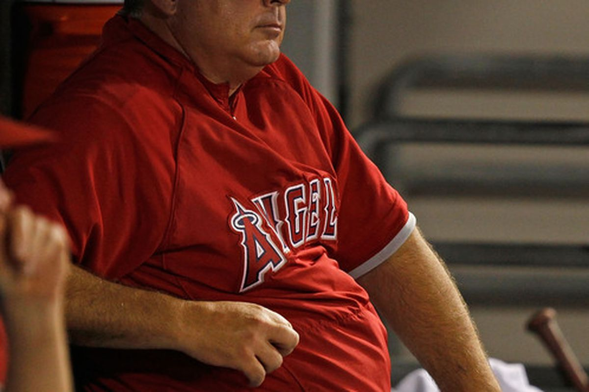 CHICAGO - JULY 07: Manager Mike Scioscia #14 of the Los Angeles Angels of Anaheim watches as his team takes on the Chicago White Sox at U.S. Cellular Field on July 7 2010 in Chicago Illinois. (Photo by Jonathan Daniel/Getty Images)