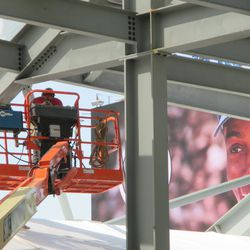 Working under the right-field bleachers -