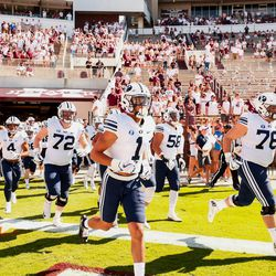 BYU football players run onto the field prior to their game against Mississippi State at Davis Wade Stadium in Starkville, Miss., on Saturday, Oct. 14, 2017.