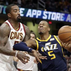 Cleveland Cavaliers' JR Smith, left, knocks the ball loose from Utah Jazz's Rodney Hood in the first half of an NBA basketball game, Saturday, Dec. 16, 2017, in Cleveland. (AP Photo/Tony Dejak)