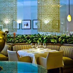 Rasika isn't the only Ashok Bajaj restaurant that comes to mind when considering iconic dining rooms. The Bombay Club is a power dining favorite offering a general atmosphere of elegance, with design touches evocative of India. Plus there's that piano in