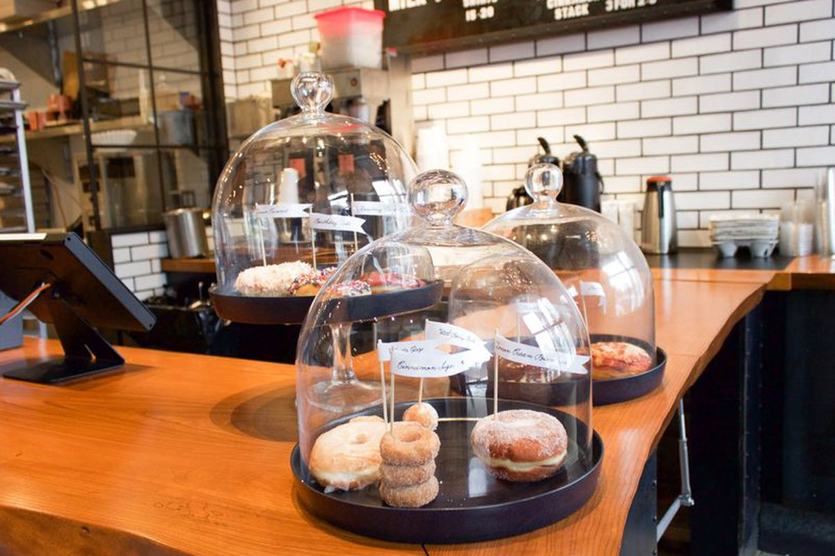 Three display cases showcase a variety of doughnuts at the original South End location of Blackbird Doughnuts