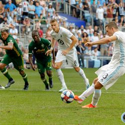 August 4, 2019 - Saint Paul, Minnesota, United States - Minnesota United midfielder Ethan Finlay (13) scores a goal off a penalty kick during the match against Portland Timbers at Allianz Field.