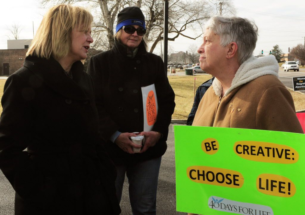 Jeanne Ives (left), who is challenging Gov. Bruce Rauner in the Republican primary,talks with Sharon Twardowski, during a Right to Life rally outside the Flossmooroffice of Planned Parenthood last month. File Photo. | John Booz/for the Sun Times