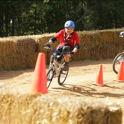 Boy Scouts try out the BMX course at the National Scout Jamboree at Fort AP Hill in Virginia Tuesday. Scouts from Utah are attending the event.