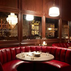 Grab a group and settle into one of the red leather booths
