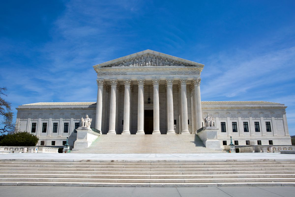 A view of the U.S. Supreme Court building on a sunny day.