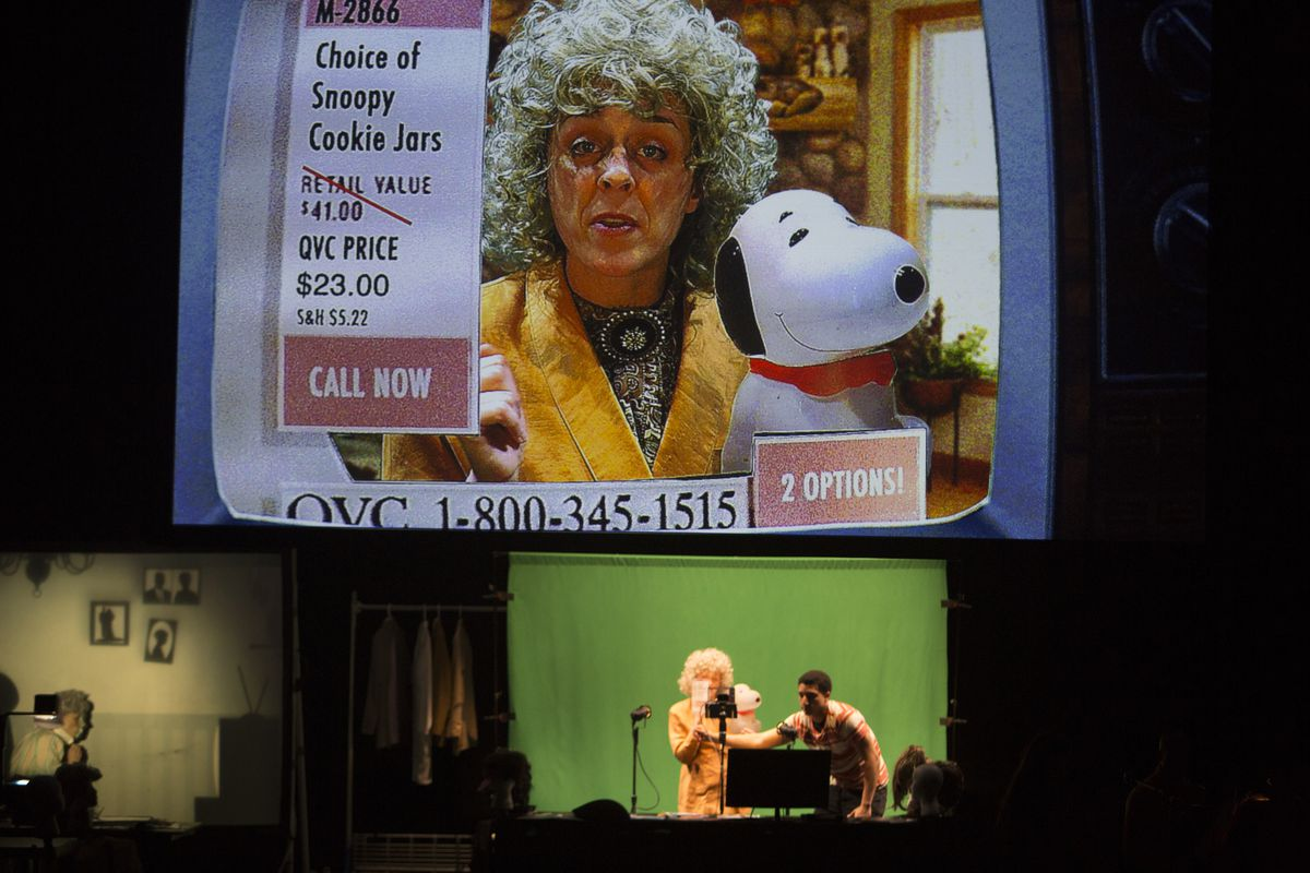 """Vanessa Valliere is a QVC home shopping host in Manual Cinema's """"The End of TV."""" Below the screen are Valliere and fellow cast member/puppeteer Jeffrey Paschal.   Judy Sirota Rosenthal"""