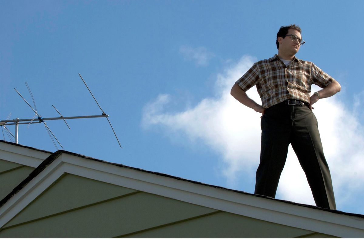 Larry (Stuhlbarg) stands on the roof.