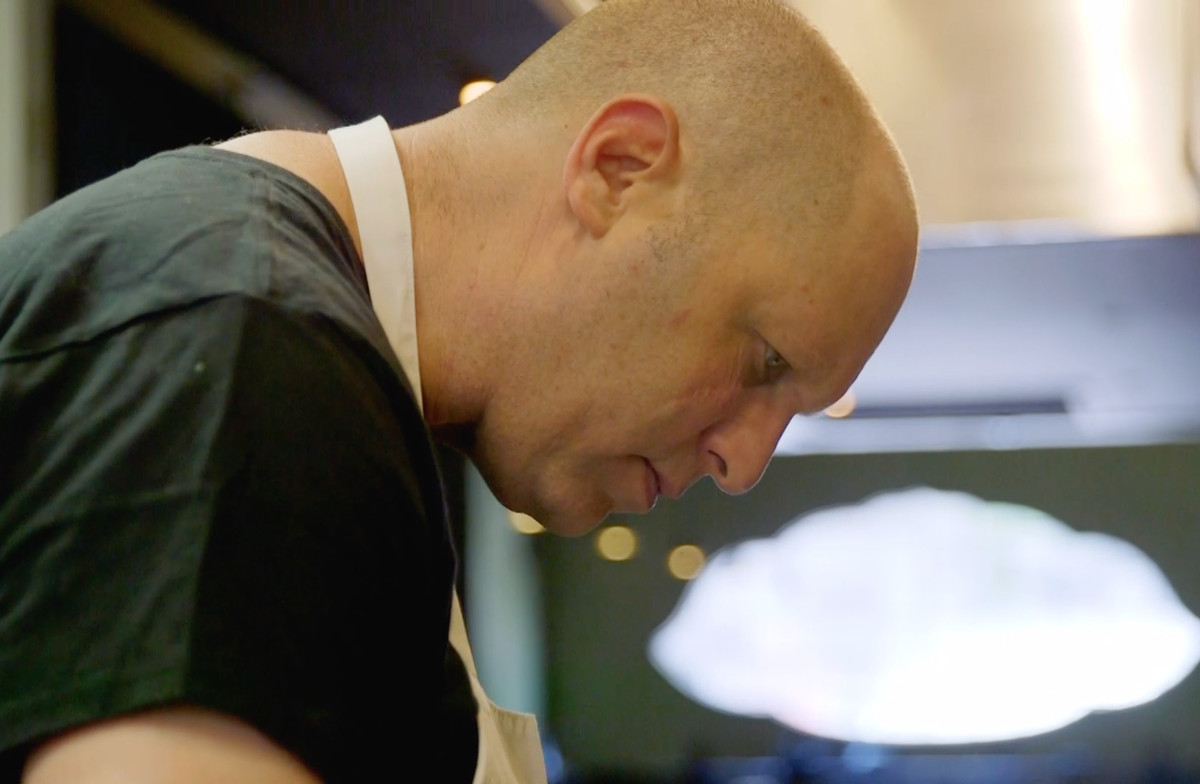 Side profile of a bald chef.