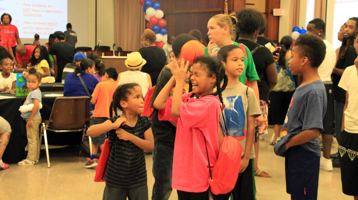 Alliyah Parks, 9, tries to catch a basketball during a game. Her mother had just finished registering her for school.
