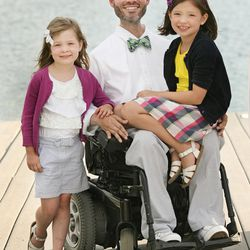 Vance Taylor poses with his daughters Isabelle, right, and Sammy, left.