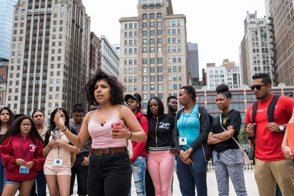 """Cit Lalli, 18, performs a poem titled """"""""We Live in a Word"""""""" during the Pop-up Soapbox, part of the Mikva Challenge mass action day at the Cloud Gate on July 24, 2017. 