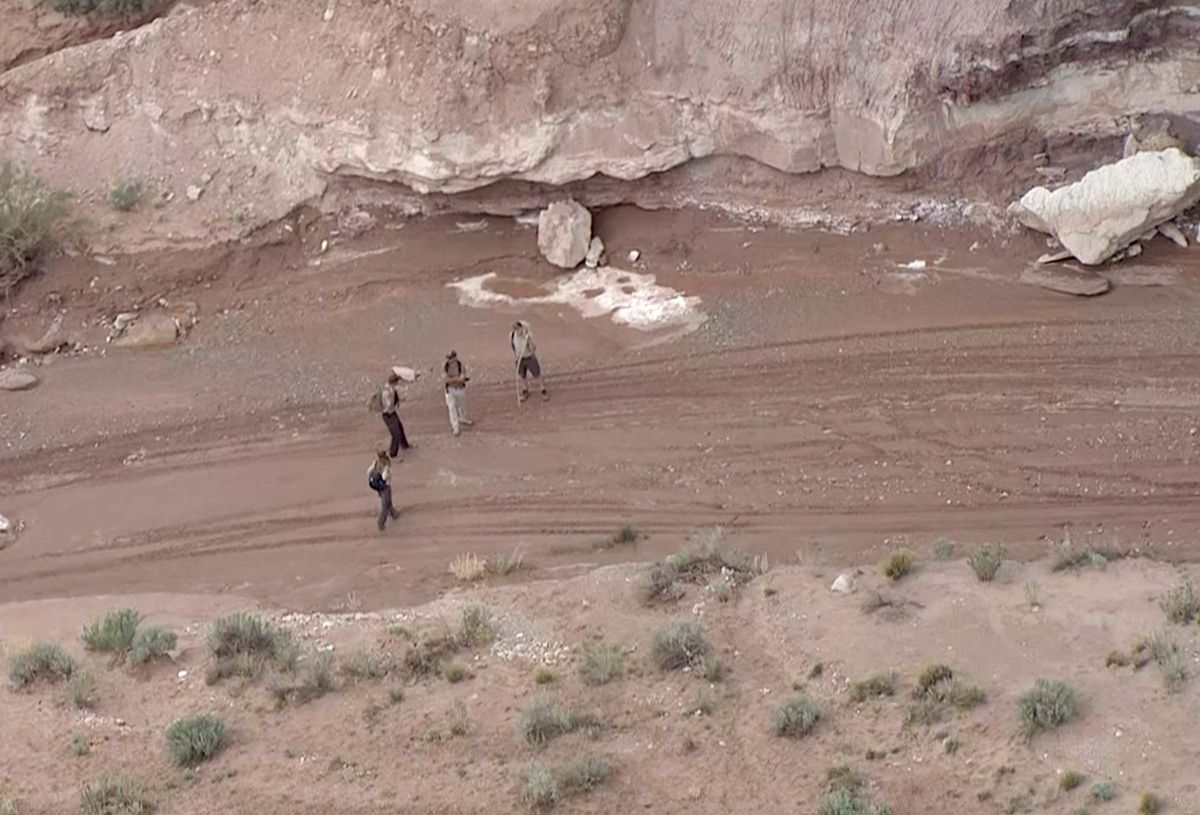 Search teams work in the area where heavy rains flooded a slot canyon near Goblin Valley State Park in an area called Little Wildhorse Canyon on Monday, May 11, 2020, that killed a 7-year-old and her 3-year old sister while they were hiking with their family.