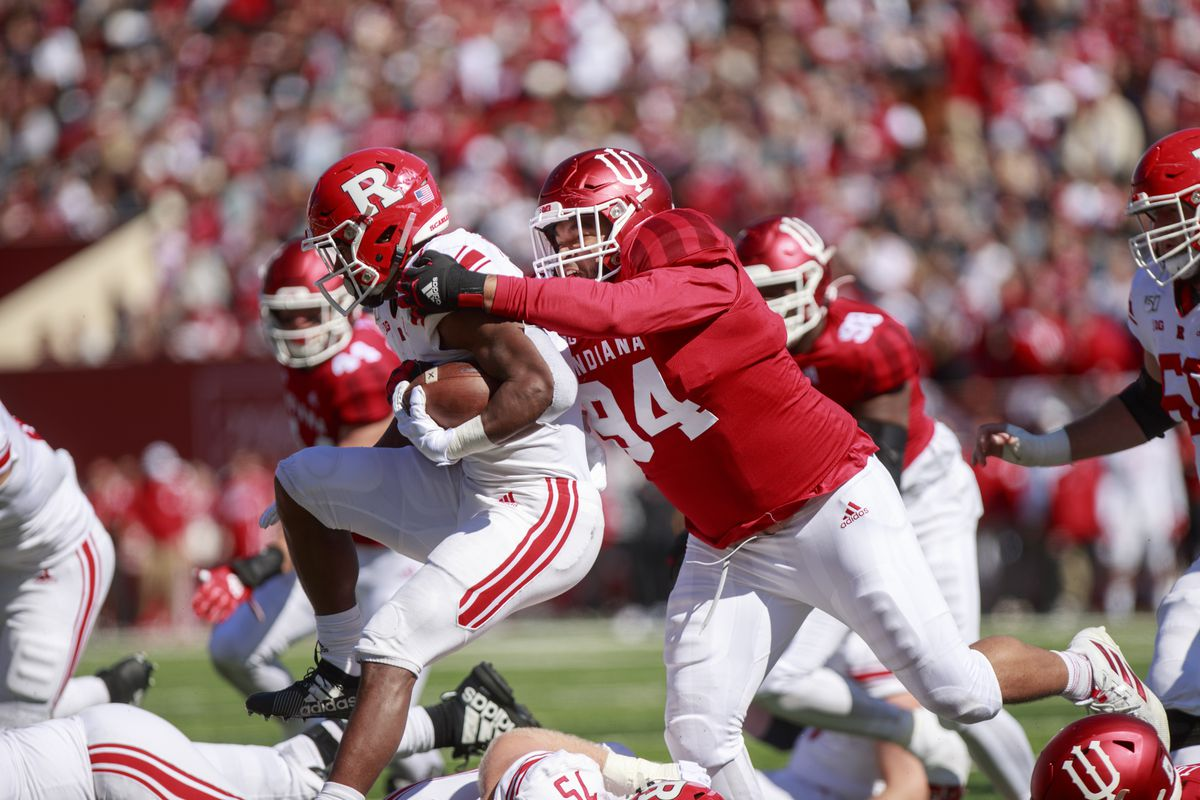 Rutgers' Isaih Pacheco (1) is tackled by Indiana University'...