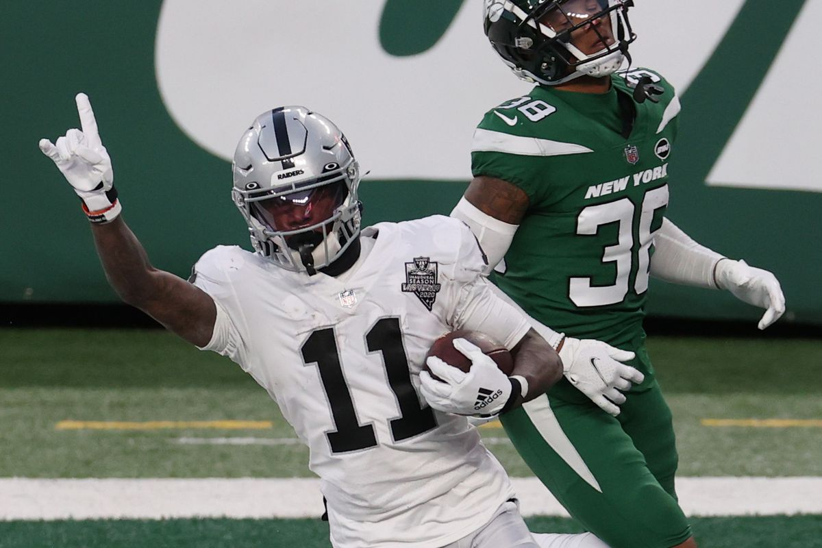 Henry Ruggs III #11 of the Las Vegas Raiders reacts after scoring a touchdown in the final seconds of the second half as Josh Adams #36 of the New York Jets looks on at MetLife Stadium on December 06, 2020 in East Rutherford, New Jersey.