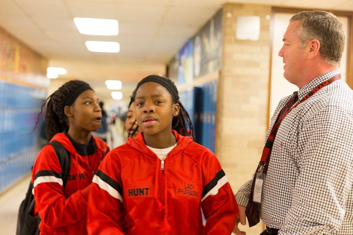 Raleigh-Egypt Middle/High School Principal Bo Griffin talks with students in the school's hallways in 2016.