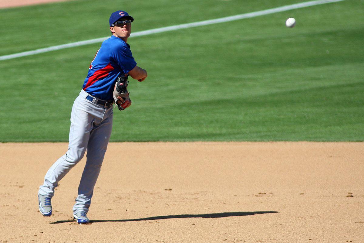 Phoenix, AZ, USA; Chicago Cubs third baseman Ian Stewart throws out Oakland Athletics catcher Josh Donaldson during the fifth inning at Phoenix Municipal Stadium. Credit: Jake Roth-US PRESSWIRE