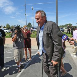 Former Utah Attorney General Mark Shurtleff leaves the Salt Lake County Jail after being booked and posting bond Tuesday, July 15, 2014, in South Salt Lake.
