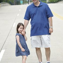 Grace Bauer, 5, takes a moment for a photo with her dad, Lt. Paul Bauer of the Chicago Mounted Police Unit, as they leave a Father's Day Mass at Gold Star Park in June 2010. | Sun-Times file photo